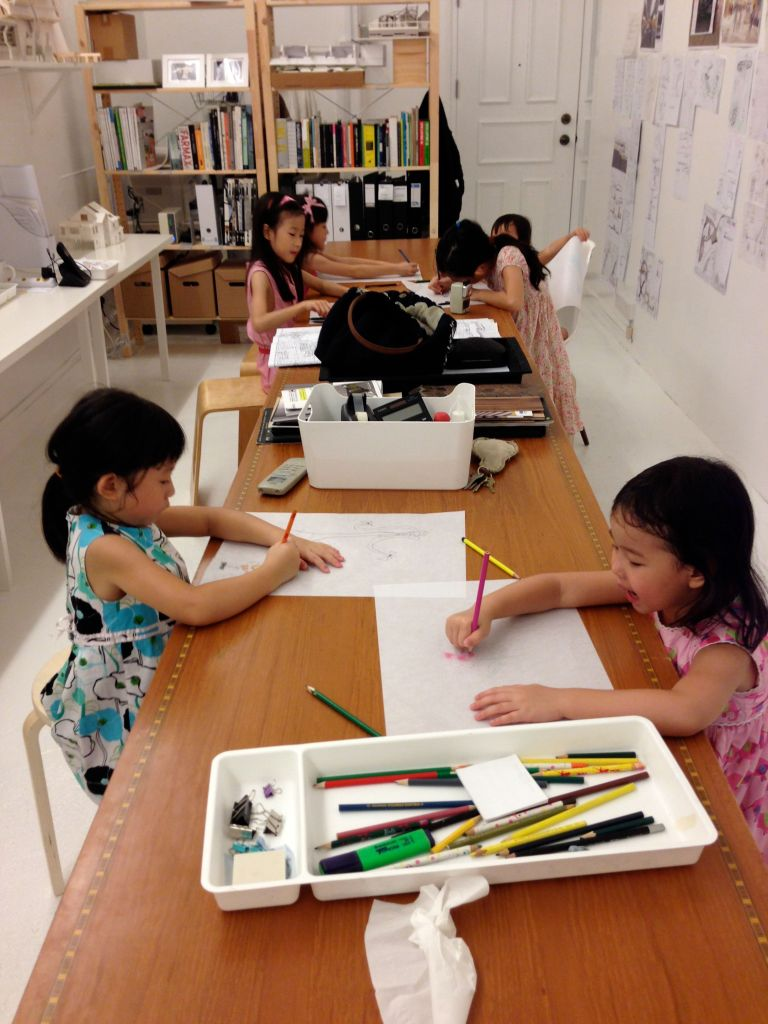 We have also moved into a proper office space over the last 2 months and this shot is of the kids (with friends' children) making full use of the LONG work table!