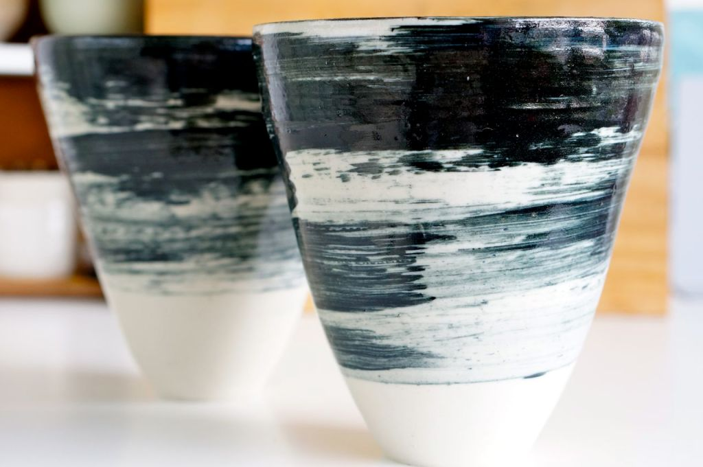 Tall white pots with a simple brushed glaze