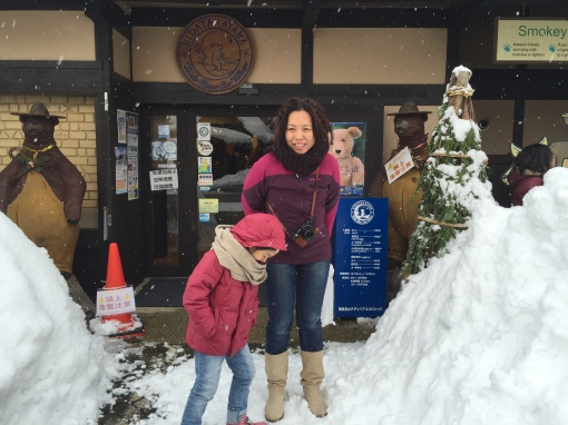 It was freezing cold! Us in front of the Teddy Bear Museum while G played with snow.